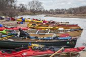 SOUTH PLATTE RIVER, EVANS, COLORADO - APRIL 6: Kayaks and canoes on a river shore during Annual All