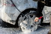 stock photo of suds  - Dirty silver car covered in suds being valeted - JPG