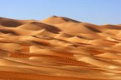 stock photo of straddling  - A dune landscape in the Rub al Khali or Empty Quarter - JPG