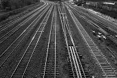 stock photo of railroad yard  - View of railroad tracks in black and white - JPG