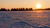 Sunset Behind Snow Field