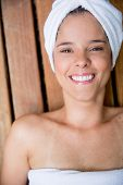 Portrait of beautiful woman smiling in a spa