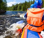 foto of rafters  - Rafters in a rafting boat on Pistojoki river in Karelia - JPG