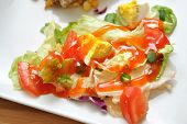 stock photo of iceberg lettuce  - Fresh Summer Salad with creamy French dressing over the top - JPG