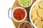 Food Appetizers Chips Salsa Refried Beans Guacamole Wood Cutting Board