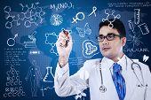 Male Doctor Is Writing On Digital Screen