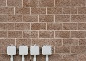 pic of cinder block  - Detail view of cinder block wall with electrical boxes - JPG