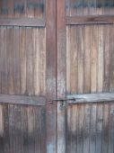 image of yesteryear  - An old ancient wooden door into the bygone era of yesteryear - JPG
