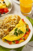 stock photo of scrambled eggs  - Homemade Organic Vegetarian Cheese Omelette with Onions and Peppers - JPG