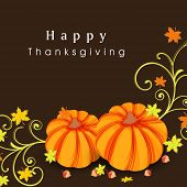 Happy Thanksgiving Day celebration concept with pumpkins on autumn leaves decorated brown background.
