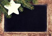 Christmas Border With Fir Tree On Vintage Christmas Blackboard Frame.  Retro Slate Chalk Board With