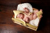 Sleeping Newborn Baby In Bonnet And Leg Warmers