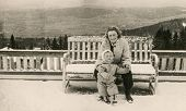 LODZ, POLAND, CIRCA FIFTIES: vintage photo of mother and baby daughter outdoor (winter), Lodz, Polan