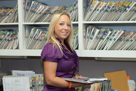 picture of medical office  - Receptionist in dental office reads patient - JPG