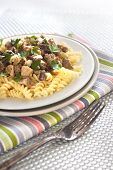 pic of morels  - Spiral pasta with morel mushrooms and parsley leaves