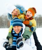 picture of cold-shoulder  - happy young family spending time outdoor in winter park - JPG