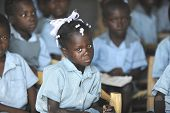 KOLMINY HAITI - FEBRUARY 12, 2014:    A young Haitian school crying girl in her classroom, surrounde