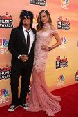 LOS ANGELES - MAY 1:  Nikki Sixx, Courtney Bingham at the 1st iHeartRadio Music Awards at Shrine Aud