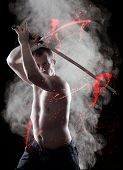 Warrior  with his Katana sword over smoky background
