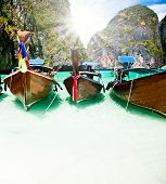 Thailand ocean landscape. Exotic beach view and traditional ship in Maya Bay, Ko Phi Phi Don