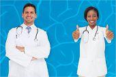 Composite image of medical team against blue brain background