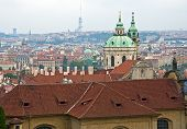 stock photo of saint-nicolas  - Saint Nicolas church and TV transmitter Zizkov in Prague - JPG