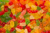 stock photo of gummy bear  - Assortment of colorful fruity Gummy Bears as background - JPG
