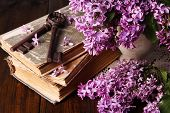 Beautiful composition with old keys and old books on wooden background