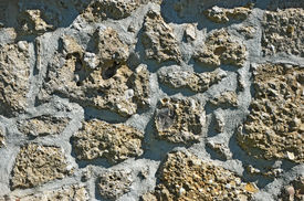 image of mortar-joint  - Old stone wall structure from individual units laid in and bound together by mortar - JPG