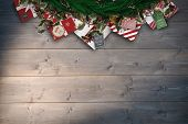 Festive christmas wreath against bleached wooden planks background