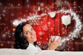 Woman enjoying a lovely drink against blurred christmas background