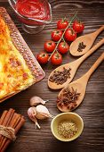 ready lasagna and its ingradent on a wooden table