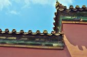 Roof of the Forbidden City under sky background