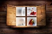 Santa delivery presents to village against window in wooden room