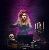 foto of dungeon  - Young and beautiful witch in a dungeon - JPG