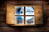 Window in wooden room against santa delivery presents to village
