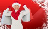 Festive woman holding shopping bags against christmas themed snow flake frame