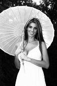 Smiling Blond Lady Holding Umbrella