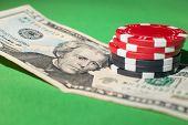 image of twenty dollars  - poker chips and  twenty dollars on a green table - JPG