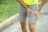 Sports injuries of man outdoors