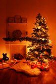 Christmas tree near fireplace in room