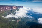 stock photo of canaima  - View from the Roraima tepui on Kukenan tepui at the fog  - JPG