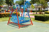 image of viking ship  - Blue swings in Viking ship pattern in playground