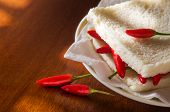 Closeup on a spicy hot chili pepper sandwich in a plate