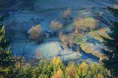 Autumn landscape. Farmstead with wooden houses. Morning with frost. Carpathian mountains, Ukraine, Europe