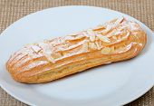 picture of eclairs  - Eclair with a cream on a plate close up - JPG