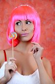 woman laughing with candy and beautiful make-up
