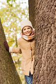 childhood, season and people concept - smiling little girl in autumn park