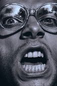 Monochrome Angry Screaming Man In Glasses