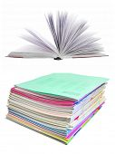 heap of school notebooks under the white background